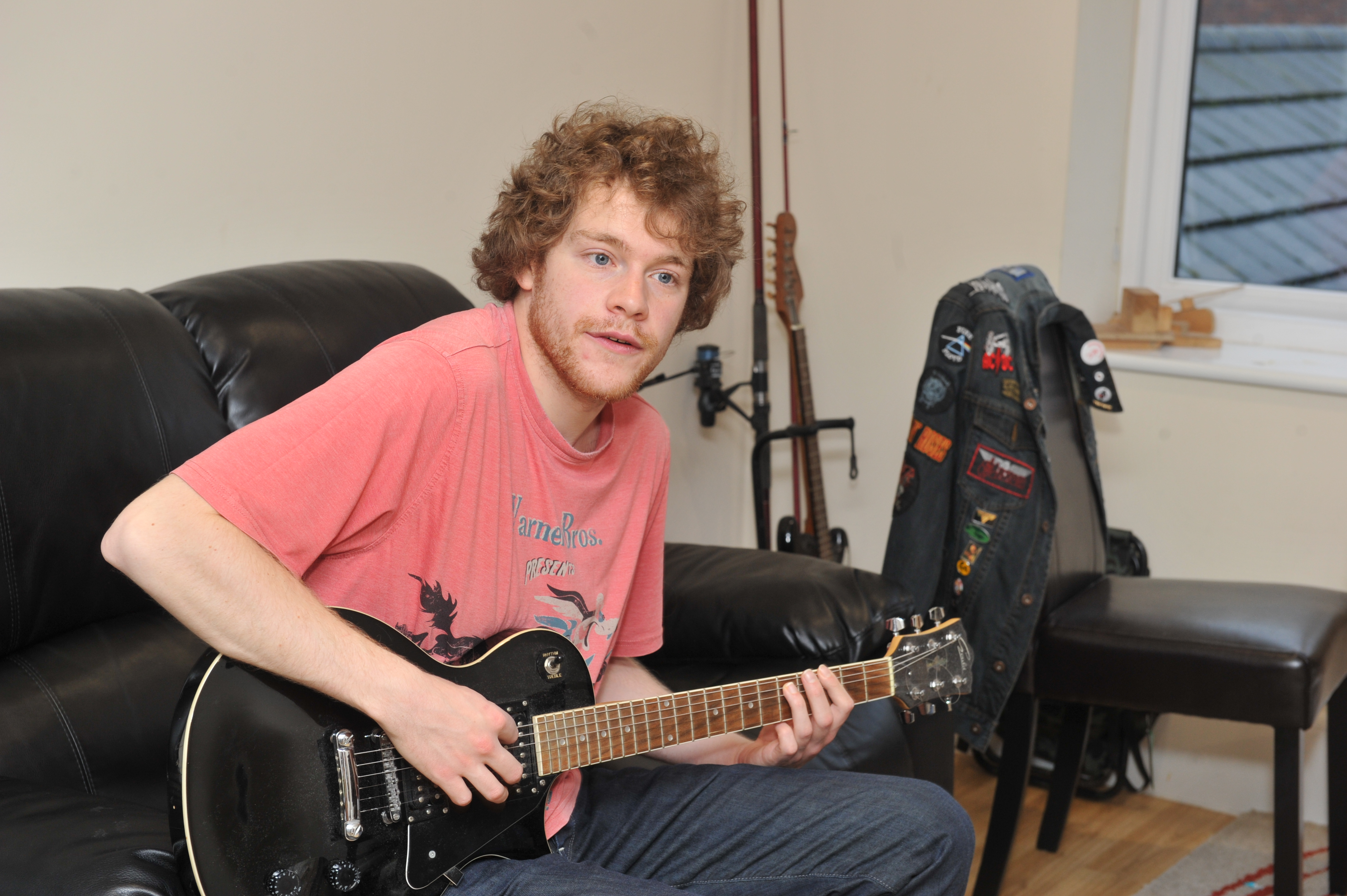 Lifeways SIL - Our Support - Boy Playing Guitar