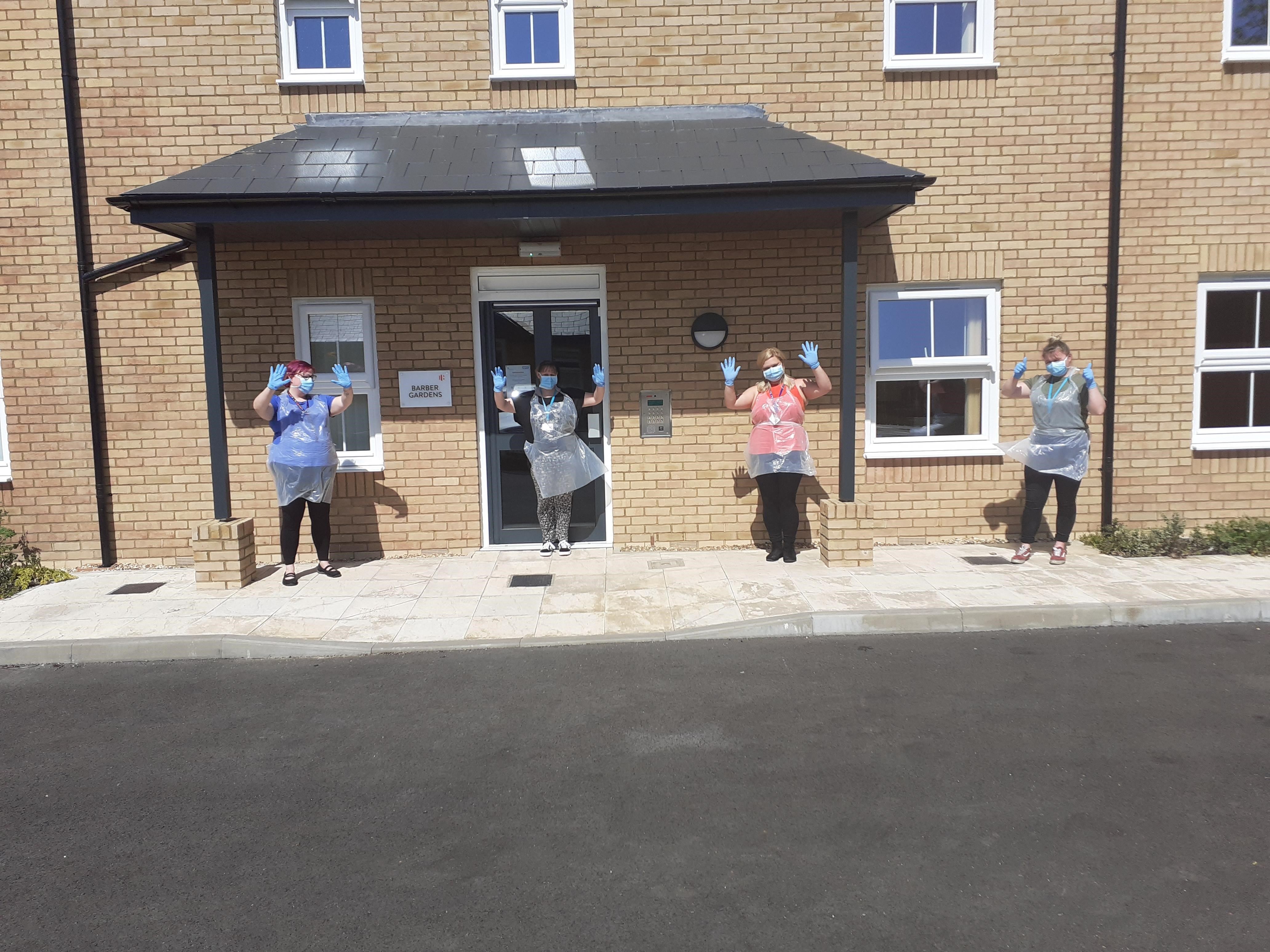 Staff outside the service wearing PPR