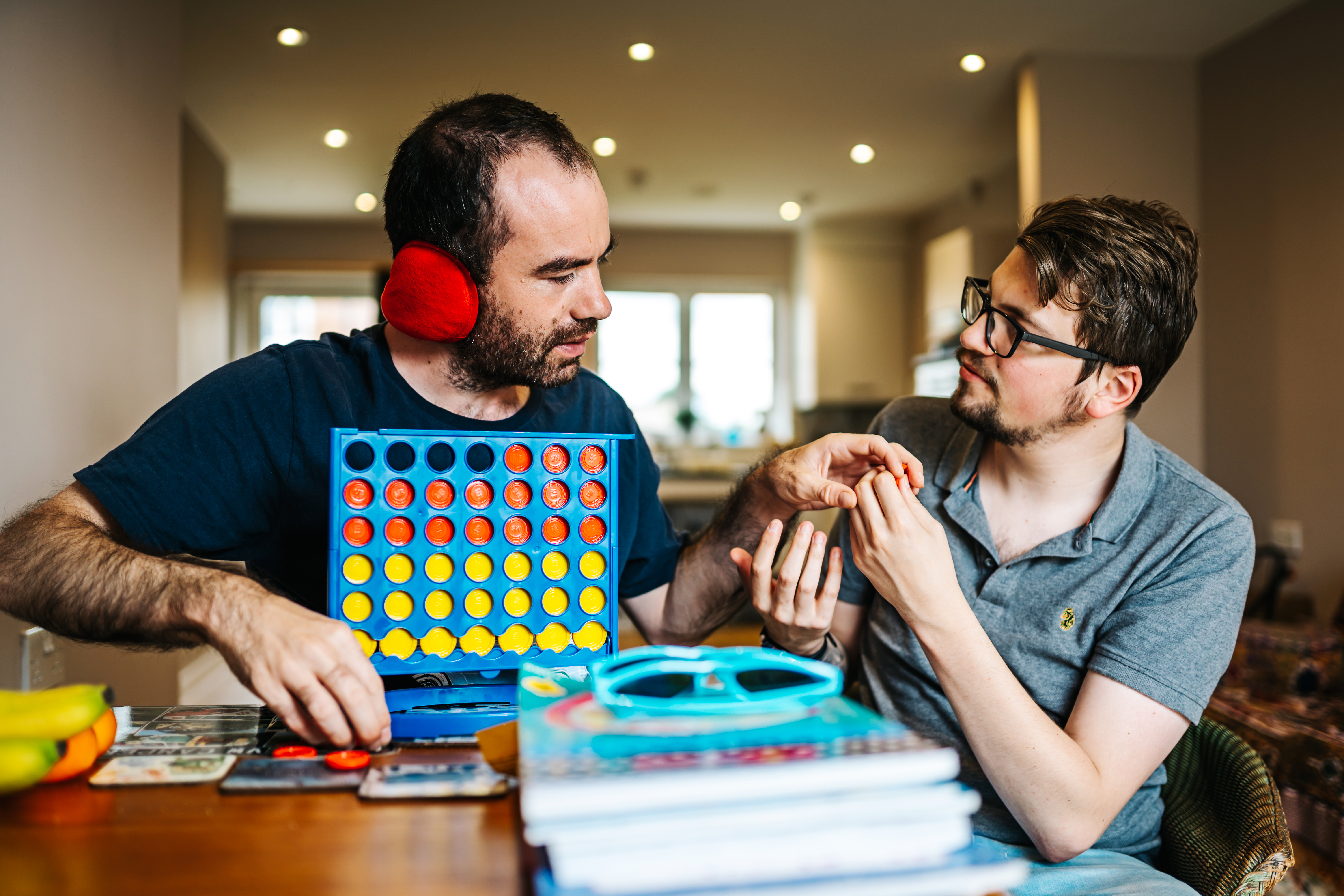 Two people playing connect four